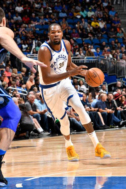 Kevin Durant of the Golden State Warriors handles the ball against the Orlando Magic on December 1 2017 at Amway Center in Orlando Florida NOTE TO...
