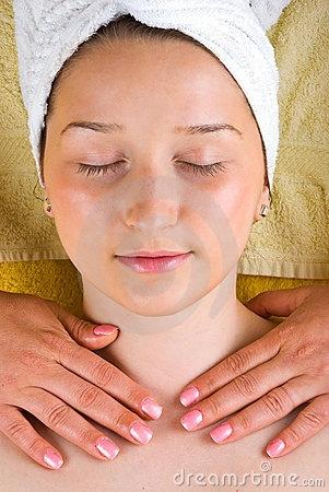 Young woman neck massage at spa salon by Gabriel Blaj, via Dreamstime
