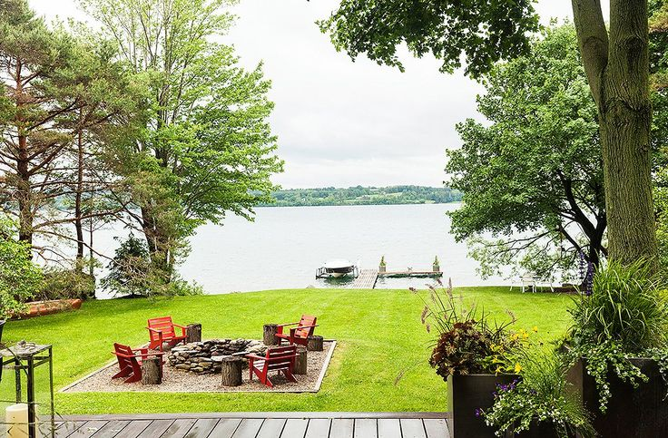 A fire pit overlooks the lake and the dock leading to Thom's beloved vintage-style Chris Craft motorboat, which he uses to visit friends around the lake.