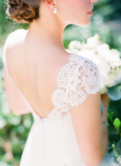 Not so much on the neutrals, but I love her dress!!!Lace wedding dress: http://www.stylemepretty.com/2014/10/13/intimate-southern-wedding-dressed-in-neautrals/ | Photography: Adam Barnes - http://adambarnes.com/