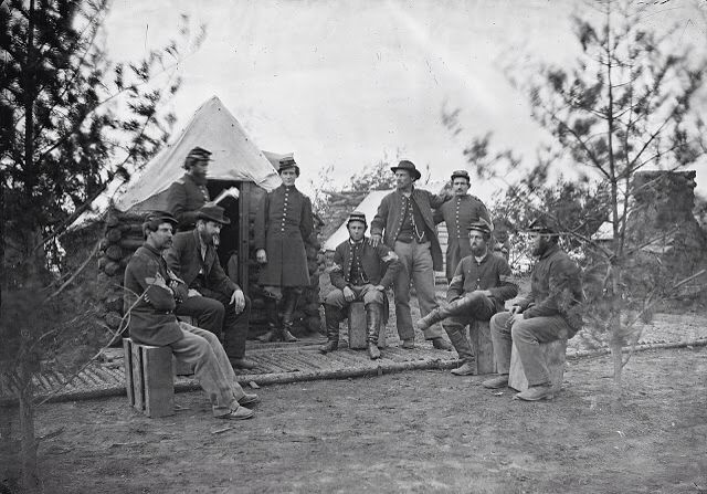 A Group of Union Officers and Non-Commissioned Officers of the 119th Pennsylvania Volunteer Infantry Regiment Posing in an Unidentified Winter Camp During the Civil War