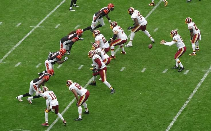 QB Kirk Cousins take the snap during the NFL London 2016 NFL regular season game at Wembley stadium between the Washington Redskins and Cincinnati Bengals.