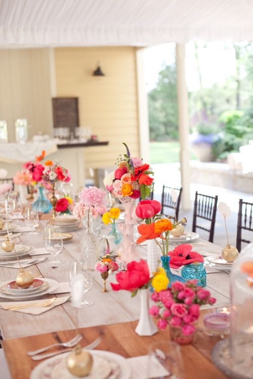 mis matched vases and flowers for table
