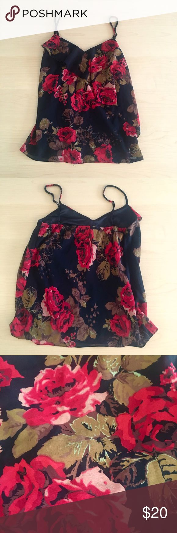 Asymmetrical Chiffon/Silk floral cami by Guess Beautiful cami by Guess! Flowy chiffon layer with an asymmetrical ruffle. Silky underlayer that makes it really comfortable to wear. Adjustable straps. Worn many times but in like new condition. Guess Tops Camisoles
