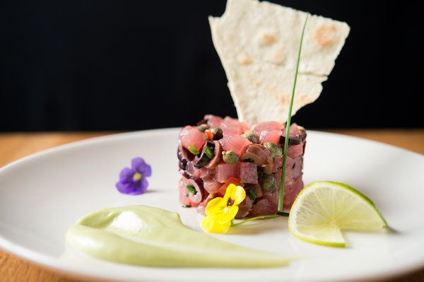 The Flatiron restaurant's sister location in Santa Monica, which opened last week, shares how to make its branzino and tuna tartare.