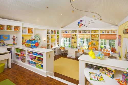 I know this is set up for toys, but can you imagine it as a craft room? Wow.