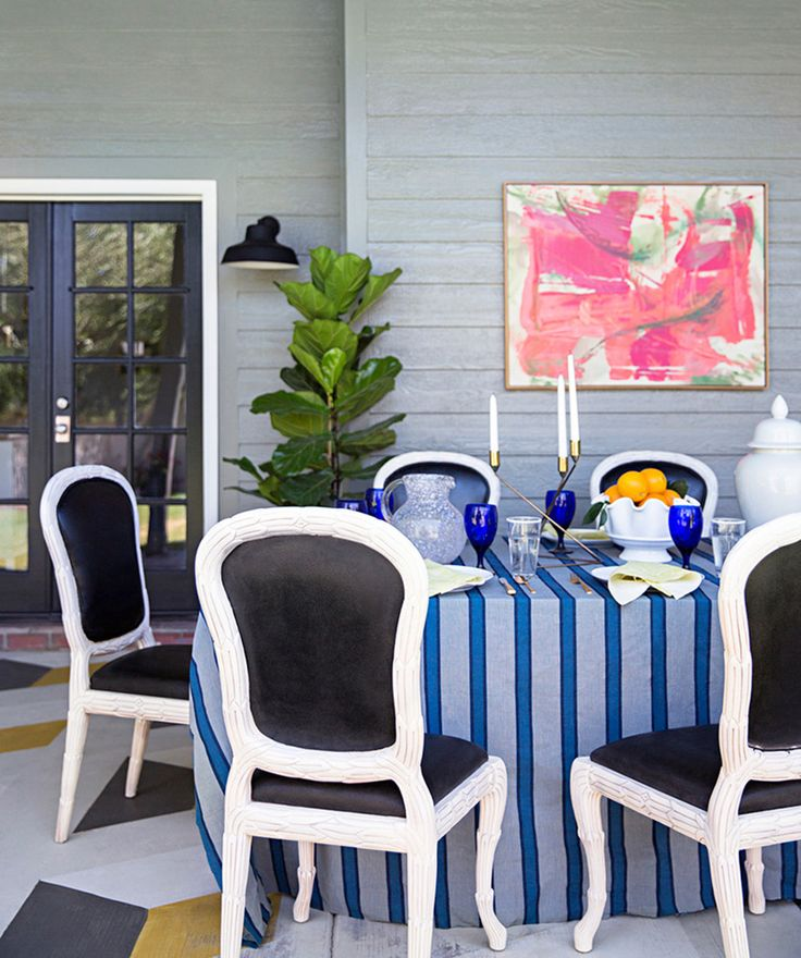 jenny komenda's southwestern home makeover - white chairs with black upholstery
