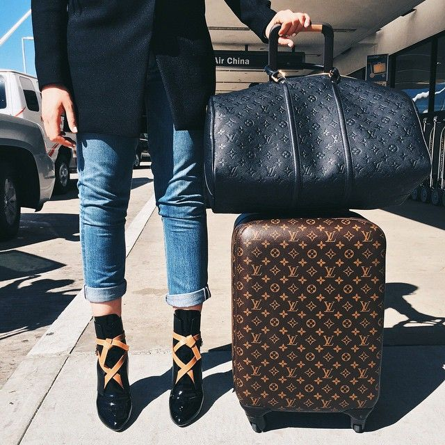 Duffle bag and a suitcase in the black monogram.