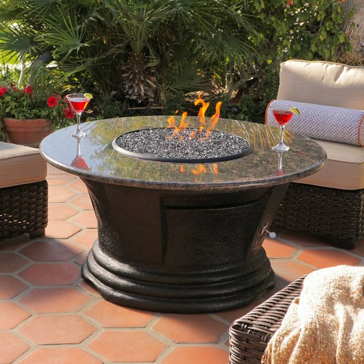 california outdoor concepts san simeon round chat height fire pit table the california outdoor concepts san simeon round chat height fire pit table puts