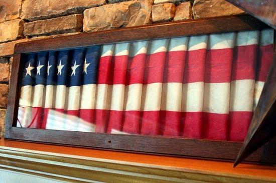 Wow~~ an old shutter painted like a flag, looks like its waving