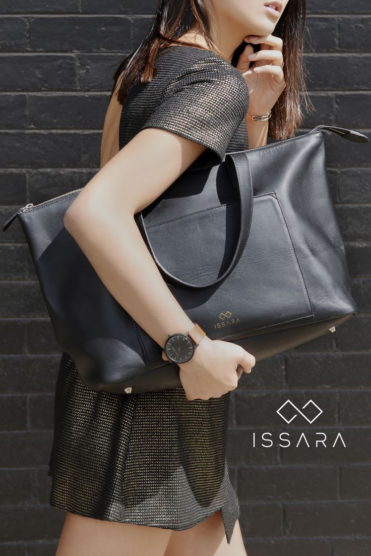 Ziptop Tote in Classic Black // An elegant take on the classic shopper, our wide ziptop tote will take you from boardroom to grocery run in style. Impeccably handcrafted from buttery-soft nappa leather, its minimalist design and easy-access compartments will keep you organised – no more corded mess at the bottom of the bag. Thoughtful touches such as brass feet, zipper closure and several compartments make this tote truly versatile.