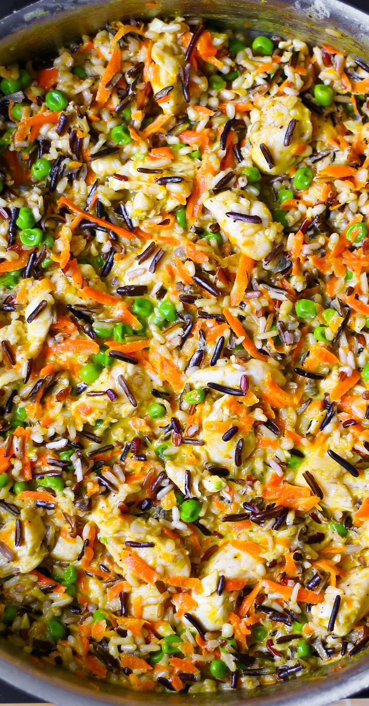 Chicken Pot Pie Wild Rice Skillet - just like the pot pie but without the pie crust!   Carrots, green peas, cream, Parmesan cheese. Gluten free recipe.