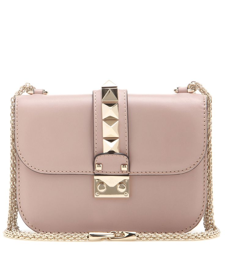 Valentino - Lock small leather shoulder bag - We love the compact shape and signature chain shoulder strap, plus the dusty pink hue and gold-tone studs that offer timeless allure. Carry it next to a printed shirt and denim shorts as an elegant final note. - @ www.mytheresa.com
