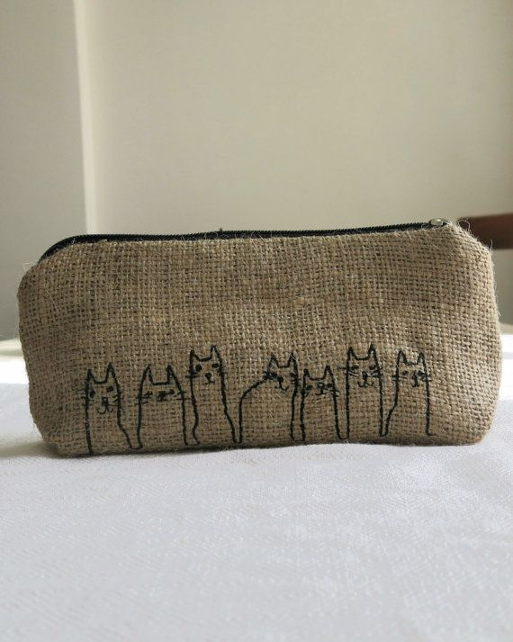 Free Shipping  Burlap Pencil Case With Cat Line. • This pencil case is produced with eco-friendly burlap. • Due to the sales we are sometimes out of the linings and we try to update the lining section regularly. • The case's height is 4,33 inches and its width is 7,87 inches. • It can be used for other purposes as well like as a coin purse.