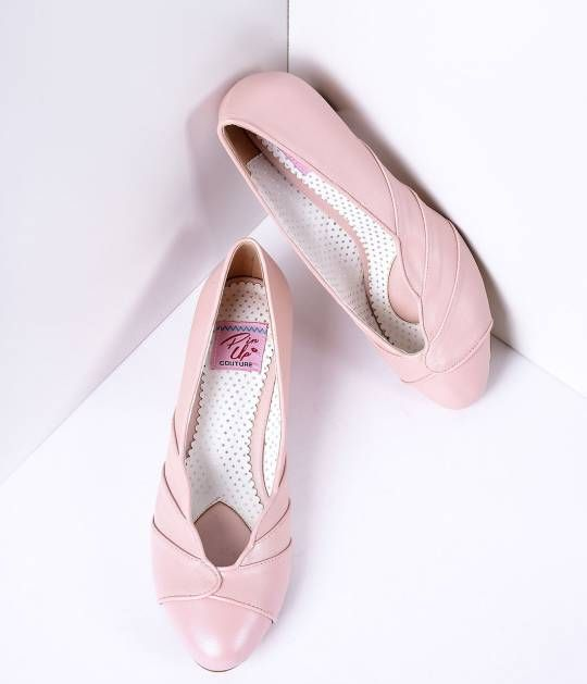 Add a touch of fun, flirty retro style to a dress or pair of high-waisted jeans with blush pink leatherette kitten heels. These authentic vintage-inspired shoes feature a rounded toe, soft insole, 1.5 inch kitten heel and a scalloped design across the top