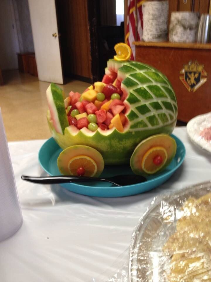 My husband made this watermelon baby carriage for our daughters shower. So cute and yummy too!