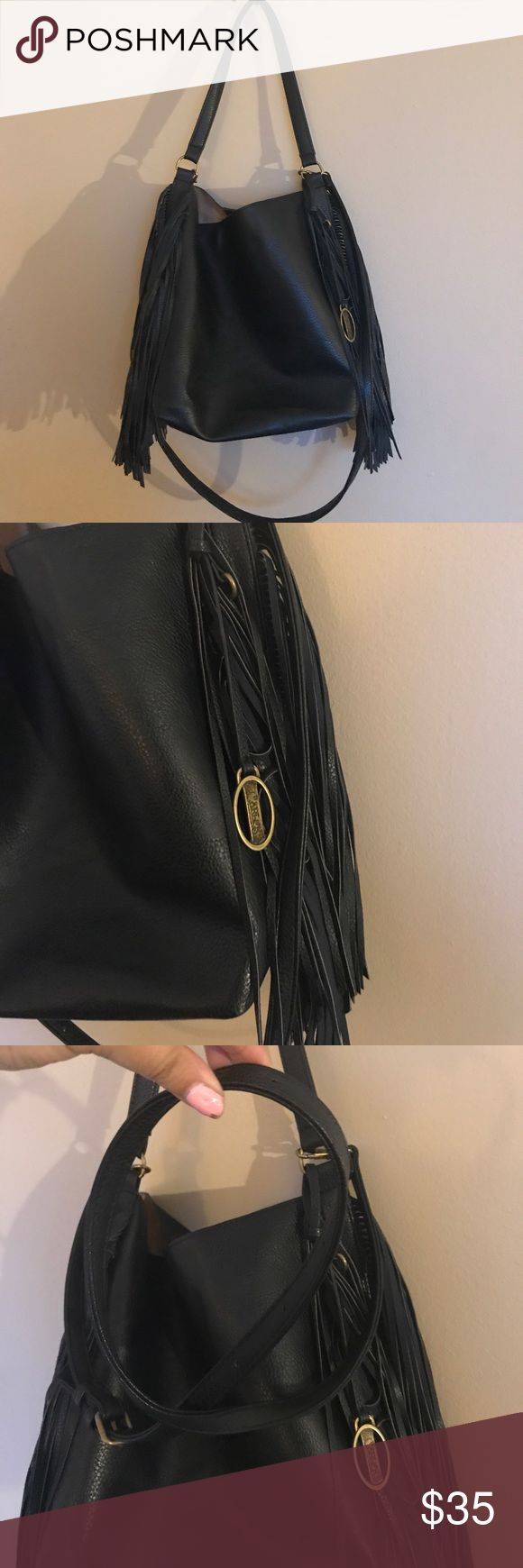 Carlos Santana faux leather black fringe purse bag Carlos Santana faux leather black fringe purse bag. Excellent condition cross body, satchel handbag from Carlos by Carlos Santana. Brassy hardware with black photo leather detail. Lining in outer is 100% polyester. Very versatile bag can be worn over the shoulder or as cross body. Strap is detachable. Perfect for festival, vacation or upcoming fall bag. I love reasonable offers, bundle and save! I ship same or next day from Ohio! 🖤💌 Carlos…
