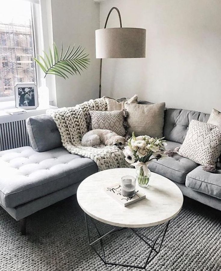 Grey sectional w/ neutral details. Marble coffee table + corner reading light. so much yess