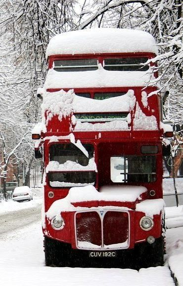 Snowy red double-decker bus, England