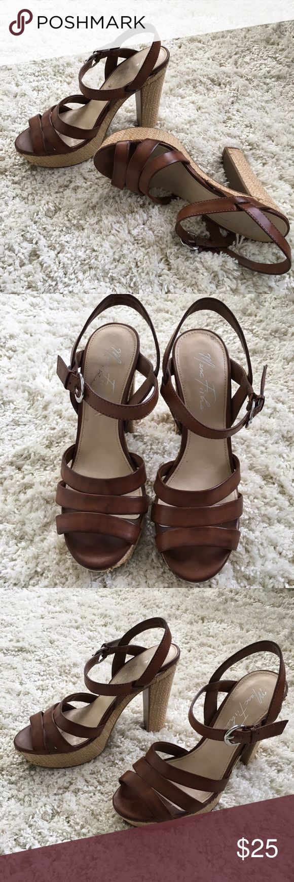 Brown Strappy Heels Brown strappy heels with a tan wicker base. Hardly worn, excellent condition except scratches on the inside sole of one heel (4th pic). Size: 7 Shoes Heels