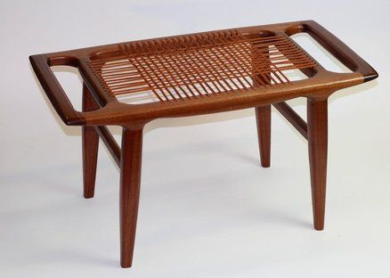 Maloof-inspired walnut bench with woven leather seat