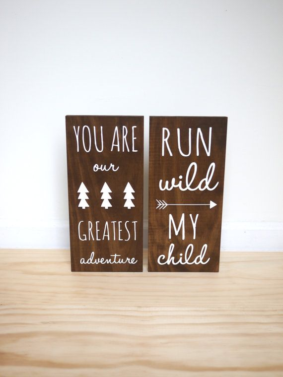 The perfect addition to a woodland, adventure, outdoor or tribal themed room! This set of TWO pine wood signs features a dark walnut stain and white