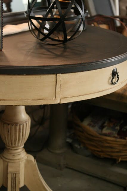 I painted the top of the table with Graphite Chalk Paint and the base with Old Ochre. I used Annie Sloan clear and dark wax over the Old Oc... http://relovedrubbish.blogspot.com/2013/02/leather-topped-table-chalk-paint.html