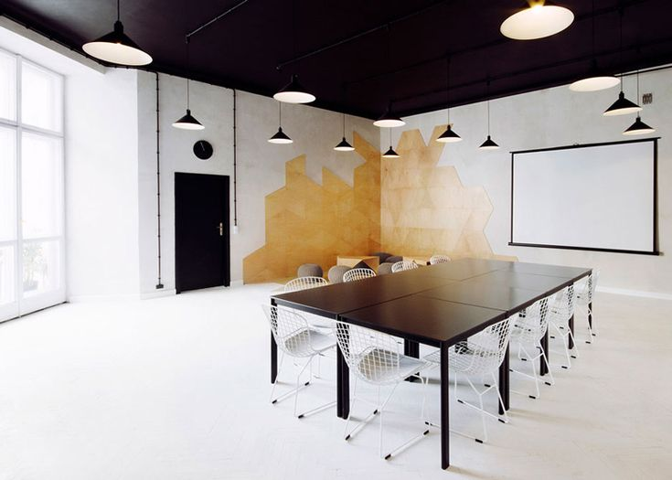 Monochrome apartment by Maciej Kurkowski and Maciej Sutuła features conference spaces