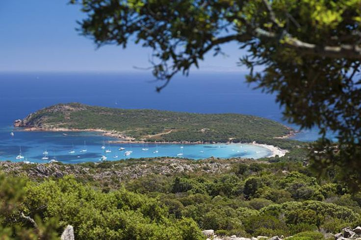 The setting of Corsica's Rondinara is almost as stunning as the beach itself. Image by photovideostock / iStock / Getty Images