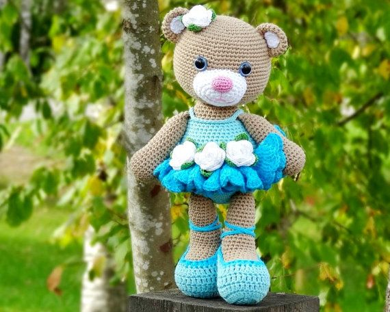 Teddy bear in a ballerina dress hand by ...