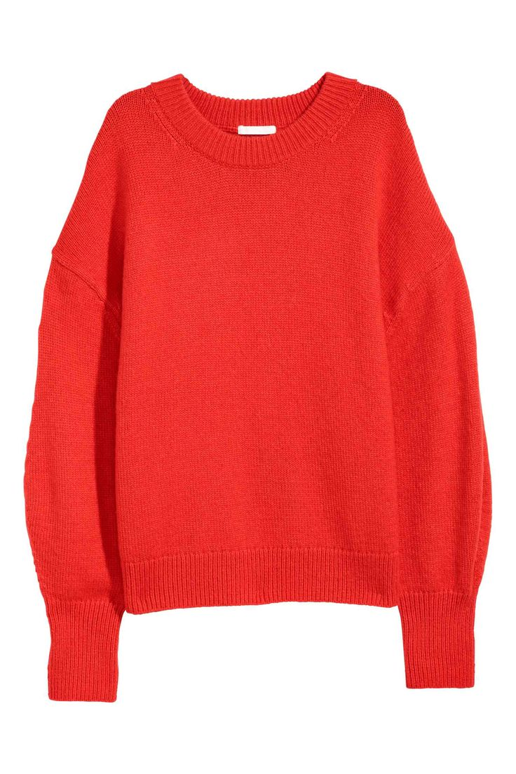 Wide jumper in a soft knit containing some wool with low dropped shoulders and long balloon sleeves.