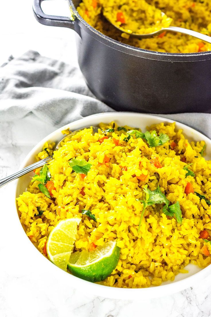 Serve this delicious Turmeric Coconut Rice for your next meal. Brown rice simmered in seasoned coconut milk with onion, garlic and thyme. #vegetarianrecipeshealthy