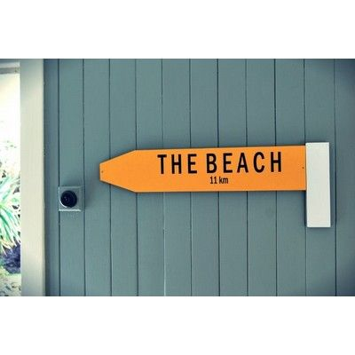 Give me a Big Sign (Wall Art) - The Beach Hand painted in genuine sign post yellow with vinyl cut The Beach. Will stand out in any home. PLEAE NOTE NOT SUITABLE FOR OUTDOOR USE. Colours: Yellow.  Size: 700 x 250mm