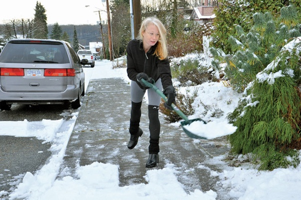 Katrine Ireland shovelling her walkway on Cornwall Street on Tuesday morning.