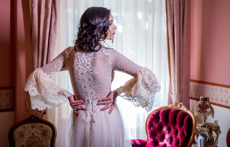 A statement bridal gown - beautiful neckline and stunning embroidered sleeves and back  Available online: https://www.fashionbylaina.eu/reve-fleur/piovine-dress