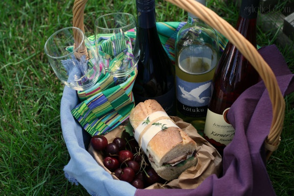 Summer picnic: Wine, Sammy with cherry preserves, brie, baby kale and ham, and Homemade Peach Popsicles!
