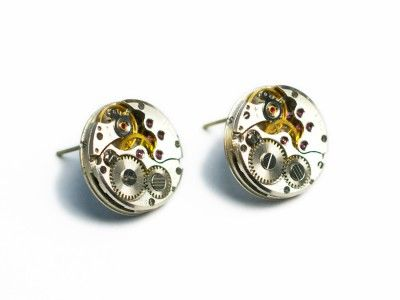 Earrings made of wristwatch mechanism.