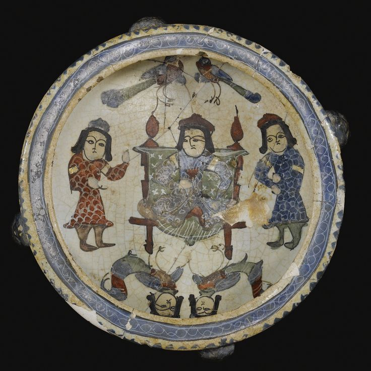 A mina'i footed dish featuring an enthroned figure with attendants, Persia, late 12th/early 13th Century