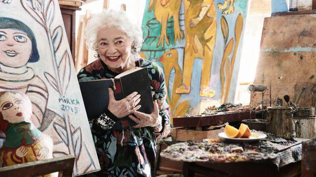 Mirka Mora in her studio wearing a Gorman dress featuring her work Naked Angel.