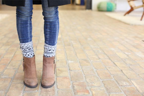 How to wear ankle boots: Layering is a good way to always look trendy, especially in the cold weather. A cool and unexpected way to achieve a nice layered style can be with socks on top of your leggings peeping out above a cool pair of laced-up booties.