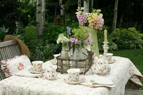 Deck furniture, floral tea cups, foxglove, hosta in the background: totally doable at my home.