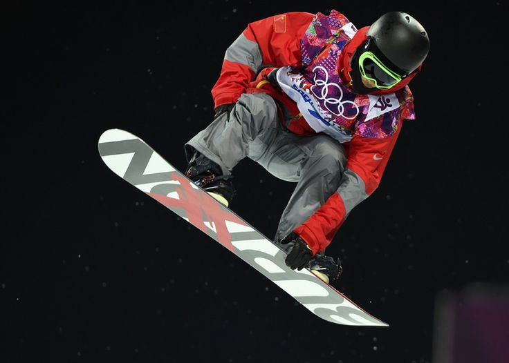 China's Zhang Yiwei is airborne during the men's snowboard halfpipe semi-final event at the 2014 Sochi Winter Olympic Games, in Rosa Khutor February 11, 2014