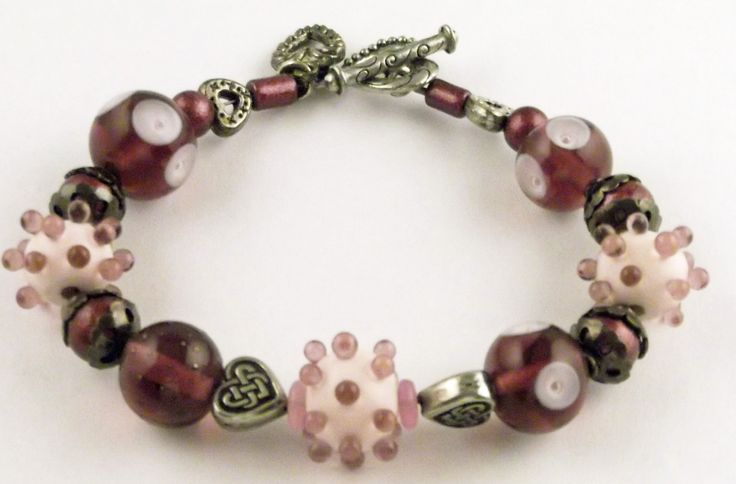 Purple and pink bracelet made with Lampwork glass beads.