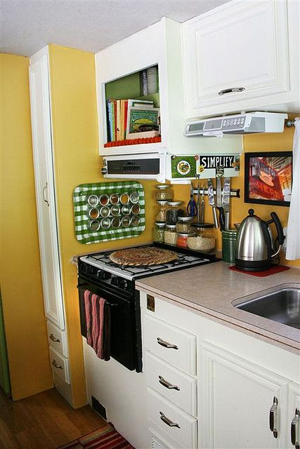 rv kitchen--I love the colorful metal tray on the wall for the spices