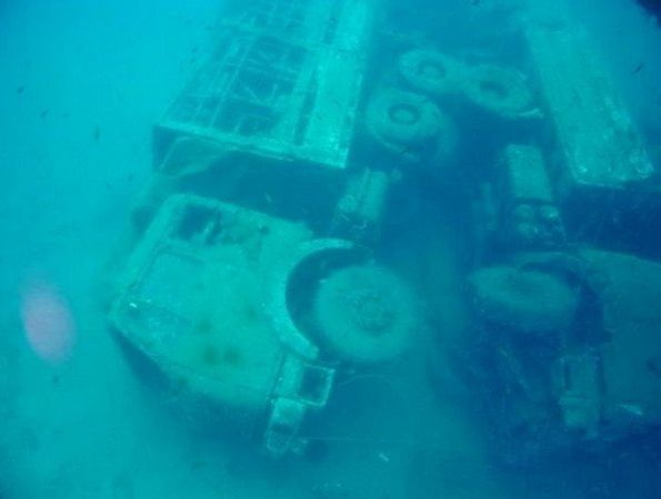 vehicles from a 10,000 ton ferry sunk to the bottom of the ocean in larnaca bay in cyprus in the 1980's