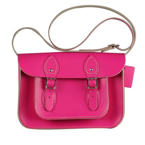"""Hand-crafted in Britain since the late 1960s, each iconic satchel is handmade and stitched using a blend of cotton and nylon for extra durability, then finished with silver buckles and rivets. The Leather Satchel's design features a long adjustable shoulder strap (4-foot) giving the satchel great versatility for people of all ages. Each bag features the Leather Satchel Co logo ensuring quality and that it's an authentic British hand-crafted satchel.  11"""" Satchel: Cabaret Pink"""