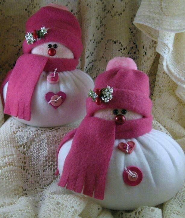 These snowman crafts are extra girly! We love the heart buttons and bright pink scarves on these cuties.