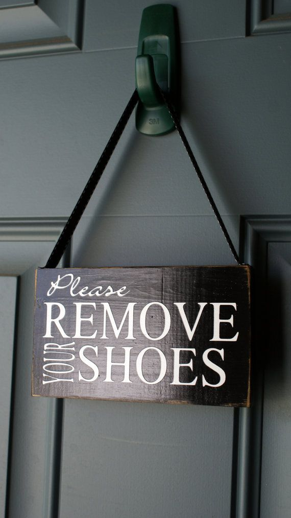 This sign measures roughly 3.5 x 6 and has painted black. White vinyl has been applied. The entire thing has been sealed with several coats of sealant. A coordinating ribbon is attached for easy hanging.  What a cute way to let your guests know to remove their shoes!  I can do almost any color combo youd like. Simply send me a convo prior to purchase to work out the details.  I LOVE TO DO CUSTOM ORDERS! CONVO ME TO DISCUSS YOUR OPTIONS
