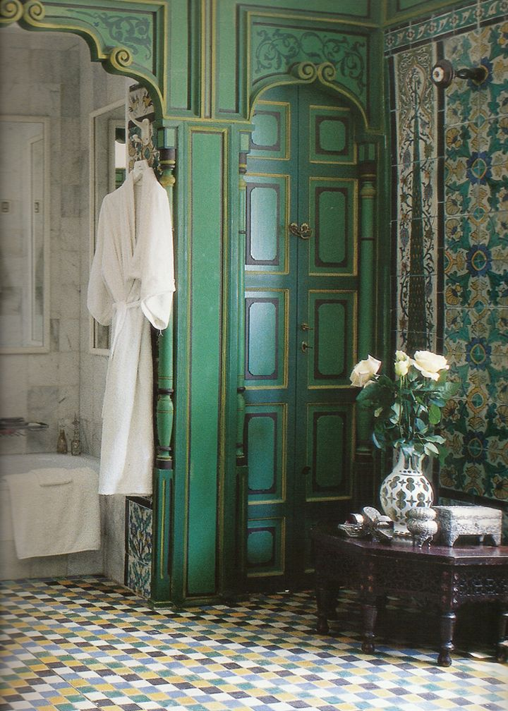 Green blue Indian Moroccan tiles and carved wood bathroom.