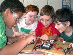 These children are learning how electricity works by building their own electrical circuit